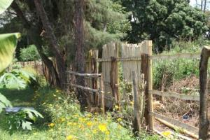 Finishing the last side of the fence on the West