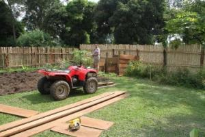 The wood around here is very heavy hard wood so we used the 4-wheeler to move the boards around.