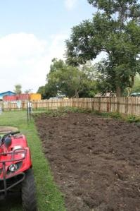 All that's left is to remove the dirt from the sod and then break up the large clumps of soil so it's workable