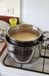 Heating the milk in a double boiler