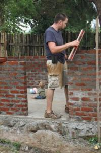 A level is used to double check that the bricks are even.